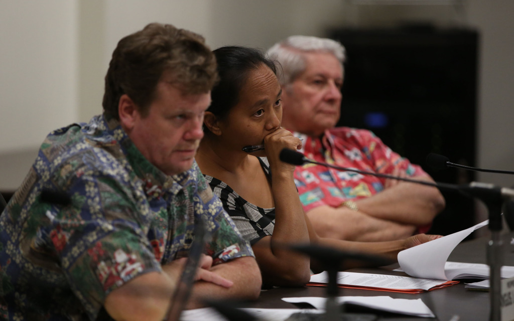 Left, Chair person Representative Angus McKelvey, Representative Della Au Belatti and Senator Sam Slom listen to Jeff Kissell, Executive Director of the Hawaii Health Connector at hearing at the Capitol. 29 dec 2014. photograph Cory Lum/Civil Beat