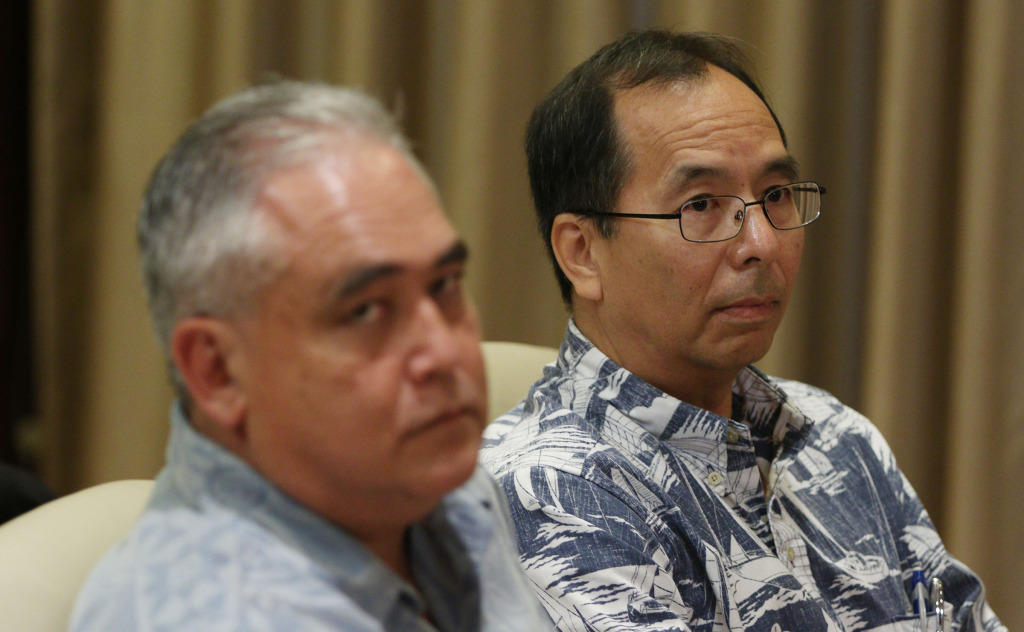 Budget Director Wes Machida and Mike McCartney looks on as Governor David Ige gives press conference on the budget at the Capitol Building.  22dec2014. photograph Cory Lum/Civil Beat