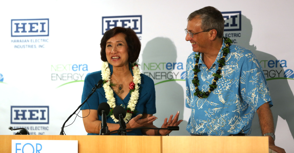 Jim Robo Chairman and CEO, NEXTERA Energy, Inc. and Connie Lau, President and CEO Hawaiian Electric Industries speak at press conference announcing a merger with NEXTERA at suite 800, 1001 Bishop Street. Honolulu, Hawaii.  3 dec 2014. photograph by Cory Lum