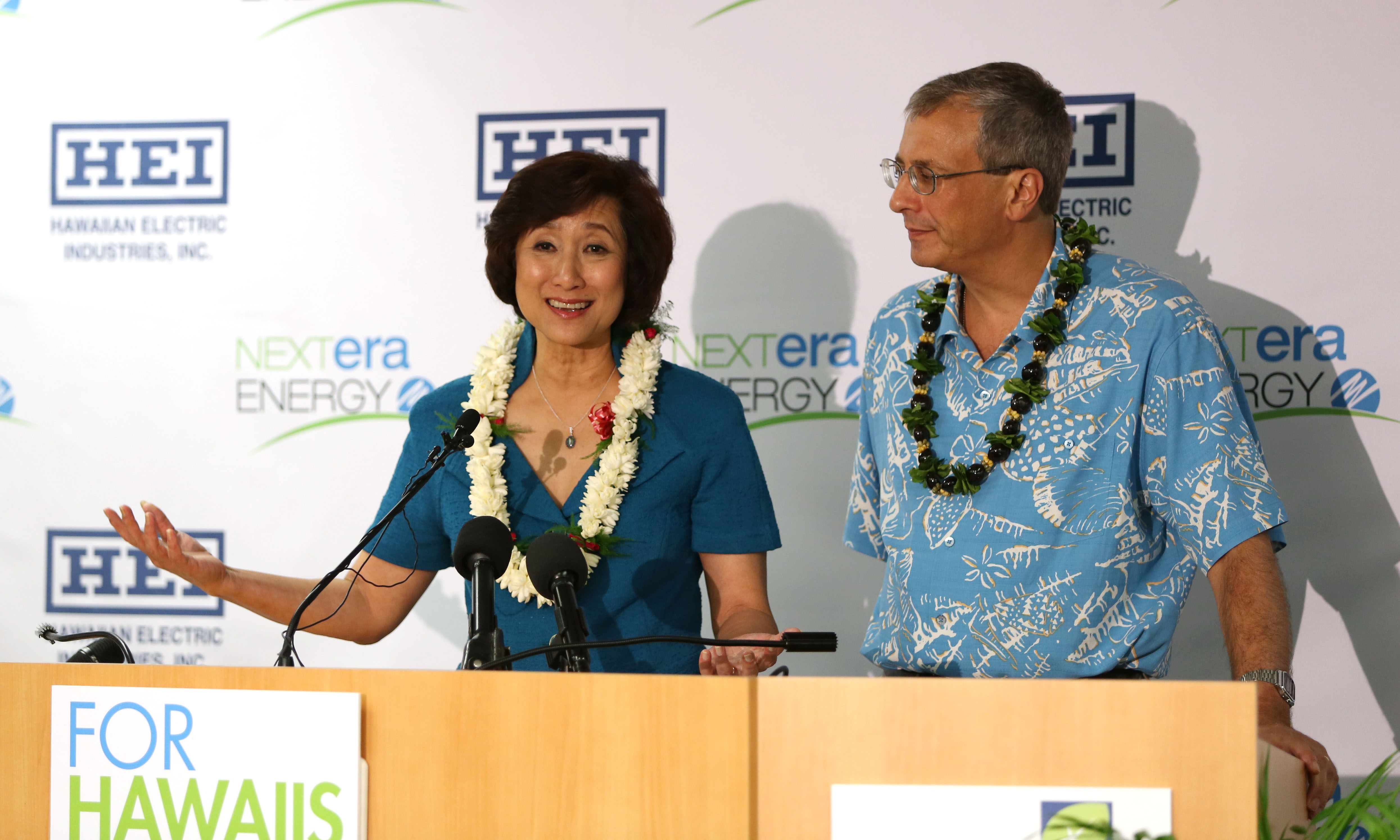 Connie Lau, President and CEO Hawaiian Electric Industries and Jim Robo Chairman and CEO, NEXTERA Energy, Inc. announce a merger with NEXTERA at suite 800, 1001 Bishop Street. Honolulu, Hawaii.  3 dec 2014. photograph by Cory Lum