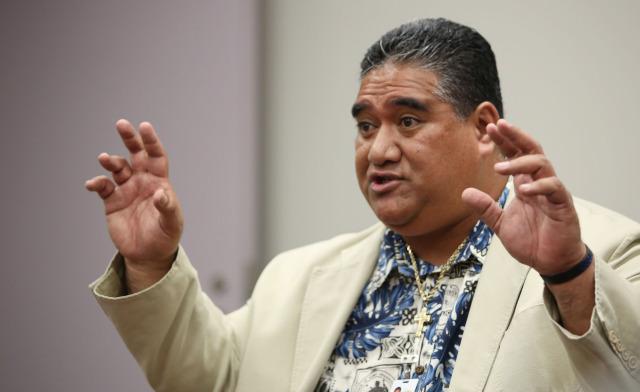 SHOPO President Tenari Ma'afala testifies on behalf of Chief Kealoha during the Honolulu Police Commission meeting held at the Honolulu Police Departments main station, conference room A. 17 dec 2014. photo Cory Lum