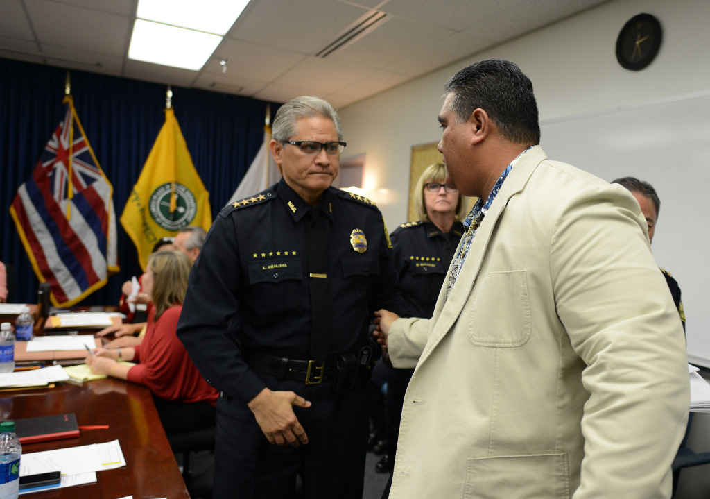 Chief Louis Kealoha speaks with SHOPO President Tenari Ma'afala as the commission heads into executive session at the Honolulu Police Departments main station, conference room A.  17 dec 2014. photo Cory Lum