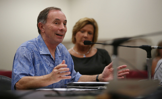 Jeff Kissell, Executive Director of the Hawaii Health Connector speaks to lawmakers at hearing at the Capitol. 29 dec 2014. photograph Cory Lum/Civil Beat