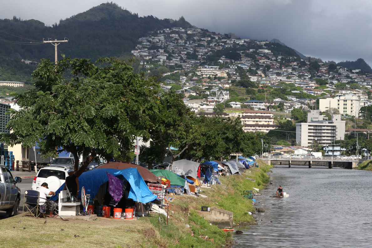 Tents along the muddy banks of the Kapalama Canal near Dillingham Street intersection where future proposed Kamehameha Schools Bishop Estate developments and rezoning is planned. 5 dec 2014. photograph Cory Lum