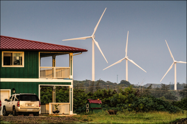 Renewable energy sources, like these wind turbines in Kahuku, have contributed to the rise of cleaner energy sources in the islands.