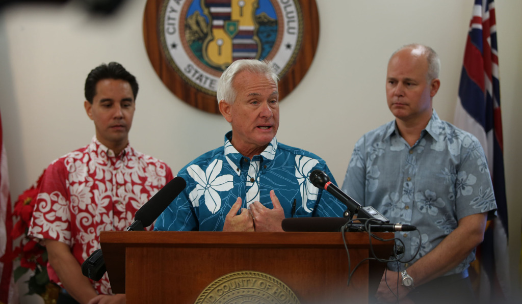 Mayor Kirk Caldwell gives press conference at Kapolei Hale flanked by left, Honolulu city council member Joey Manahan and right of photo, CEO HART Dan Grabauskas.  18 dec 2014. photo Cory Lum