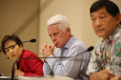 Center, HART Boardmember Michael Formby at HART board meeting held at Kapolei Hale flanked left, HART boardmember Carrie Okinaga and right, HART Board Chair Ivan Lui-Kwan. 18 dec 2014. photo Cory Lum.