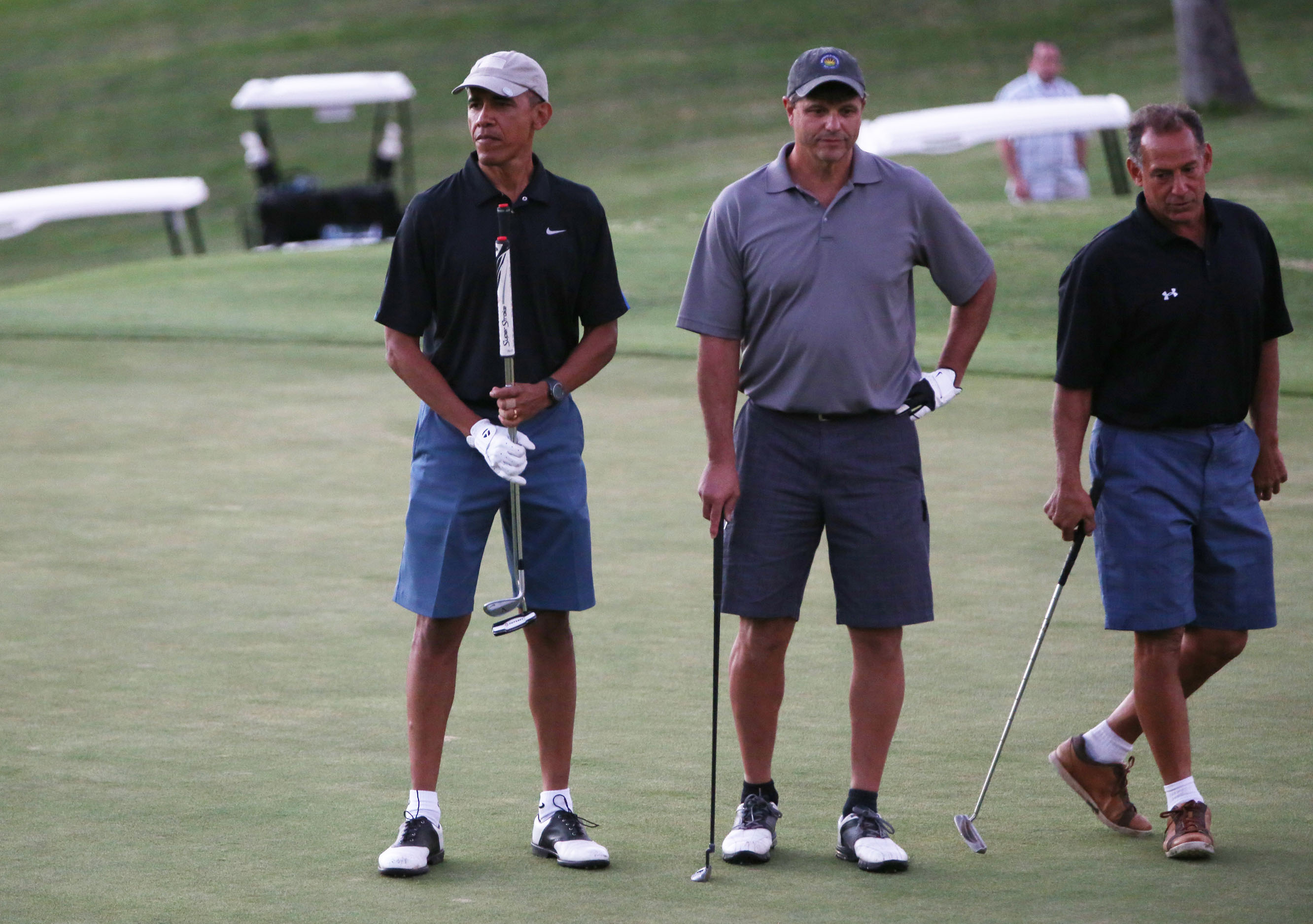 President Obama stands with Greg Orme and Bobby Titcomb on the 18th green.