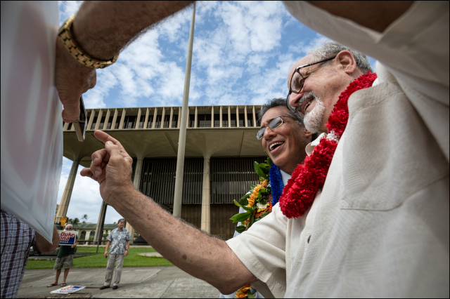 Former Lt. Gov. Duke Aiona poses for a cell phone picture with Kimo Sutton, the Republican candidate for Lt. Governor who was sign waving for Aiona at the Hawaii State Capitol. 5.19.14