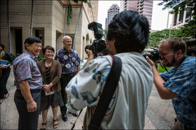 Ivan Lui Kwan, Chairman of HART Board of Directors, Donna Leong, Honolulu Corporation Counsel, Dane Gerabauskas, Executive and CEO of HART pose of photographs after news conference announcing the end of two federal lawsuits involving rail. 2.18.14 PF Bentley/Civil Beat