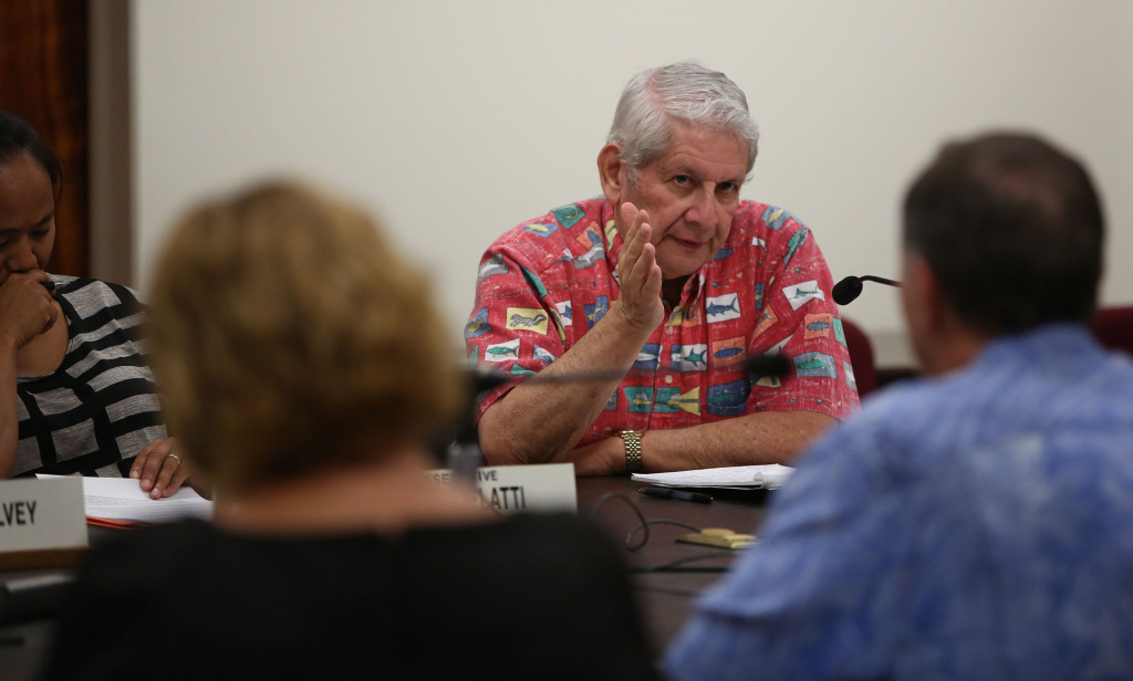 Senator Sam Slom questions Jeff Kissell, Executive Director of the Hawaii Health Connector  at hearing at the Capitol. 29 dec 2014. photograph Cory Lum/Civil Beat