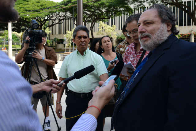 Federal Public Defender Alexander Silvert tells media case against his client Gerard Puana has been dismissed. 16 dec 2014. photograph Cory Lum