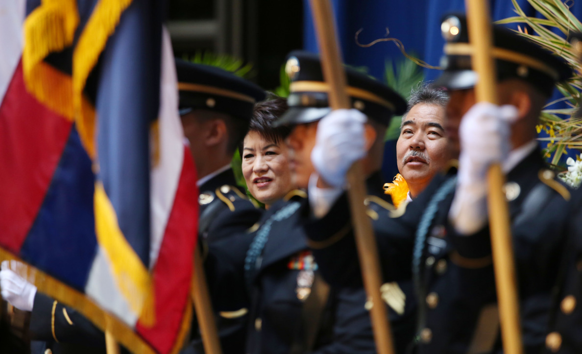Gov.-elect David Ige stands with his wife, Dawn, as members of the 100th Battalion and 442nd Regimental Combat Team of the U.S. Army  present the colors.