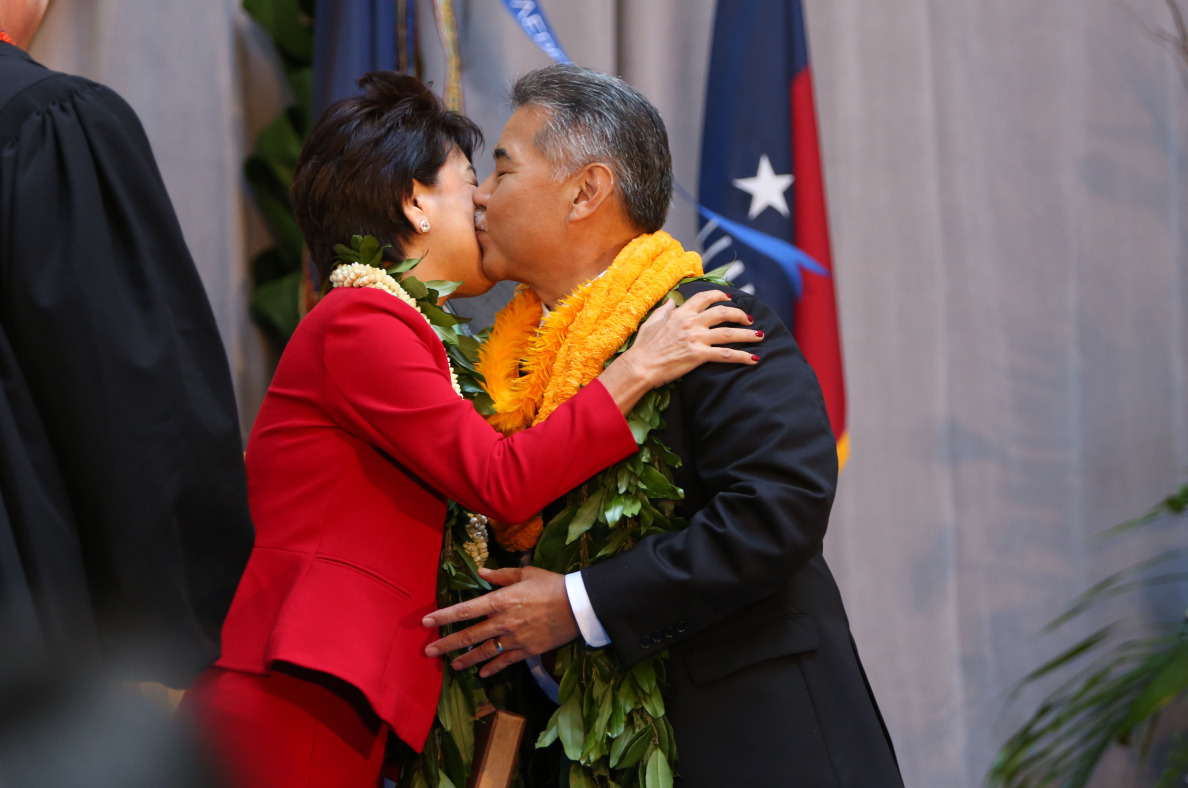 Hawaii's new First Lady, Dawn Ige, gets a kiss from the state's eighth governor.