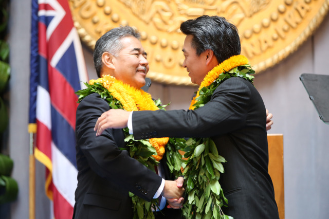 Governor David Ige embraces Lieutenant Governor Shan Tsutsui after the oath of office during Inauguration ceremonies held at the Capitol building's rotunda area. 1 dec 2014. photo Cory Lum