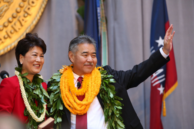 Governor David Ige and wife Dawn wave after ige took the oath of office.  1 dec. 2014. photo Cory Lum