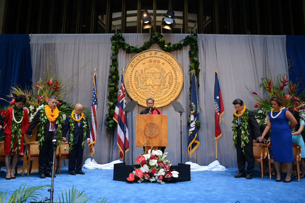 Just before the oaths of office are taken, the Rev. Danny Akaka, Jr., gives an invocation.