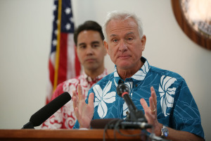 Mayor Kirk Caldwell gives press conference at Kapolei Hale flanked by left, Honolulu city council member Joey Manahan.  18 dec 2014. photo Cory Lum