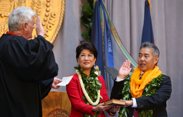 Chief Justice Recktenwald administers the oath of office to Governor Elect David Ige and wife Dawn. 1 dec 2014. photo Cory Lum