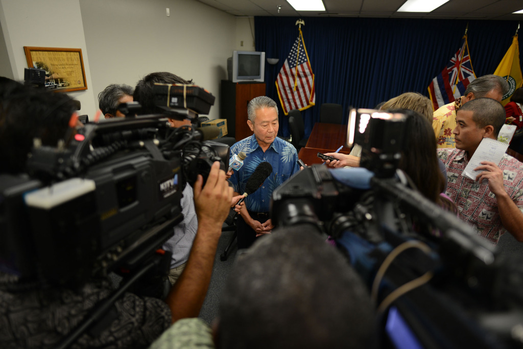 Honolulu Police Commissioner chair Ronald Taketa speaks to media following executive session at HPD headquarters. 17 dec 2014. photograph Cory Lum