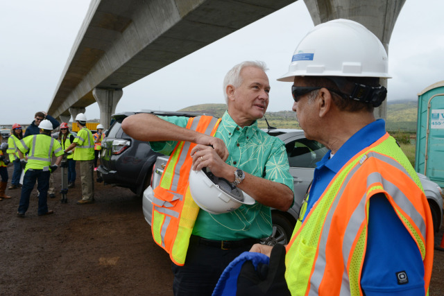 Mayor Kirk Caldwell suits up with safety gear before press conference is held by HART officials at the elevated track near Kapolei.  3 dec 2014. photograph Cory Lum