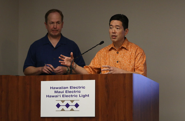 Right, Hawaiian Electric Vice President Colton Ching and left, Senior Vice President, Customer Service speak to media during press conference.  20 jan 2015. photograph Cory Lum/Civil Beat