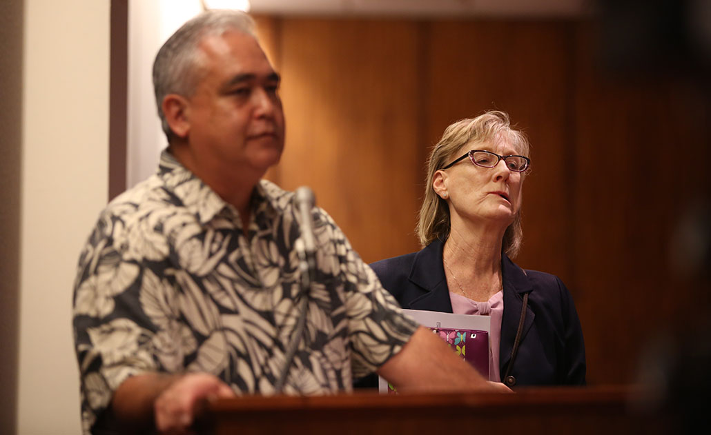 Laurel Johnston, Gov. David Ige's deputy chief of staff, reacts as Chief of Staff Mike McCartney is questioned during an informational hearing at the Capitol.