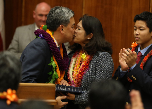 Representative Mark Takai gives his wife Sami Takai a kiss after taking his oath of office at the Federal Court. 16 jan 2015.  photograph Cory Lum/Civil Beat