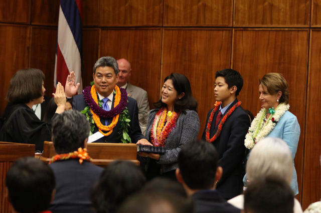 Left, Judge Susan Oki Molllway gives Representative Mark Takai his oath of office at the Federal Court as wife, Sami Takai, son and daughter and Minority Leader of the United States House of Representatives.  16 jan 2015