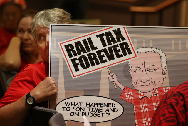 demonstrator signs ways means finance commmittee rail tax