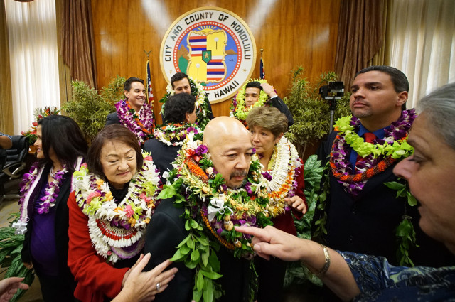 Ernie Martin, Honolulu City Council Chair stands bedecked with lei on City Council inauguration day on January 3, 2015. photograph Cory Lum/Civil Beat