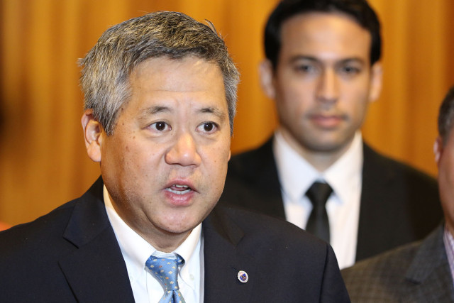 House Majority Leader Scott Saiki speaks at a press conference in January.