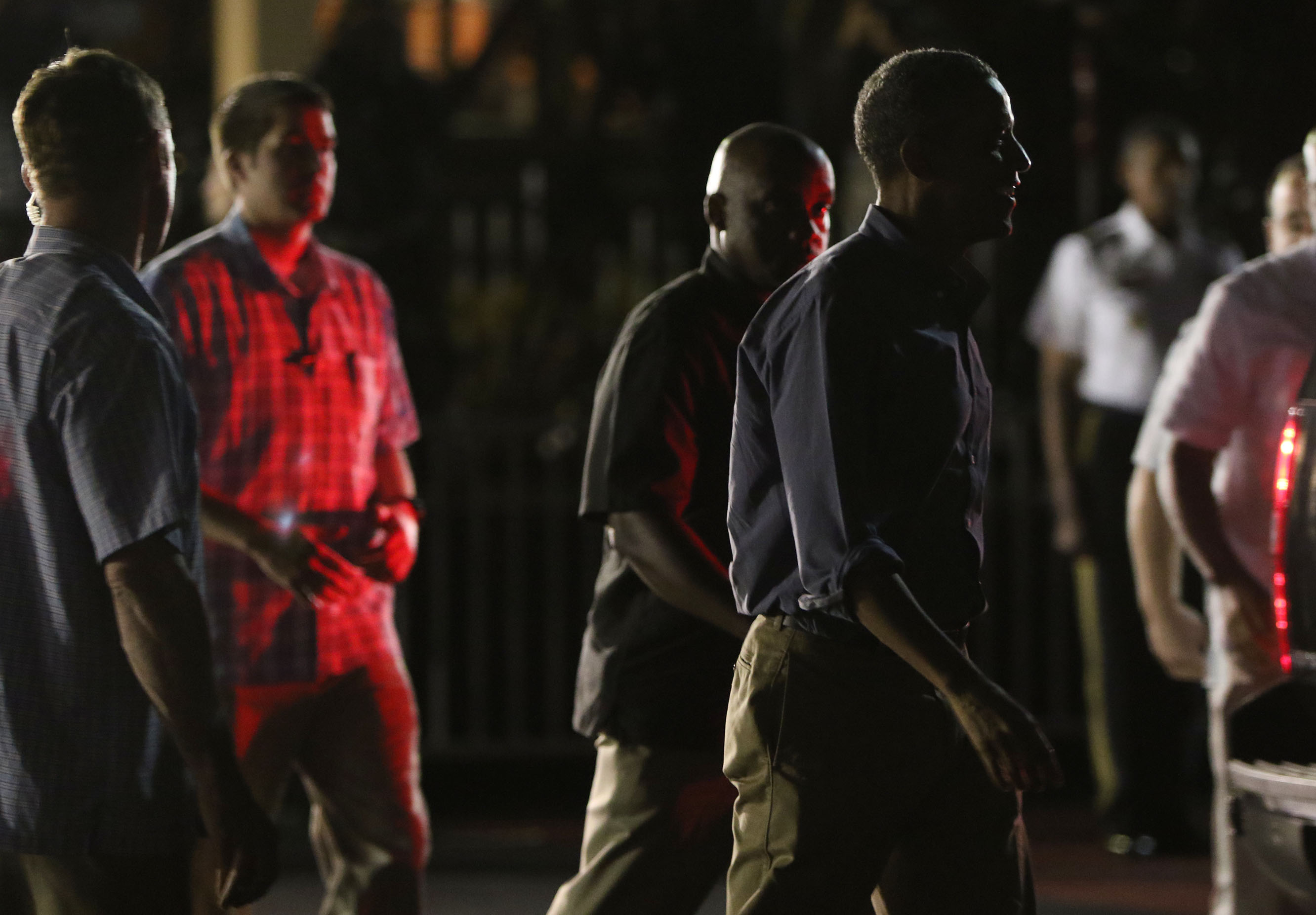 President Barack Obama walks toward Air Force One for the flight back to the mainland Saturday night after greeting people at Joint Base Hickam Pearl Harbor.