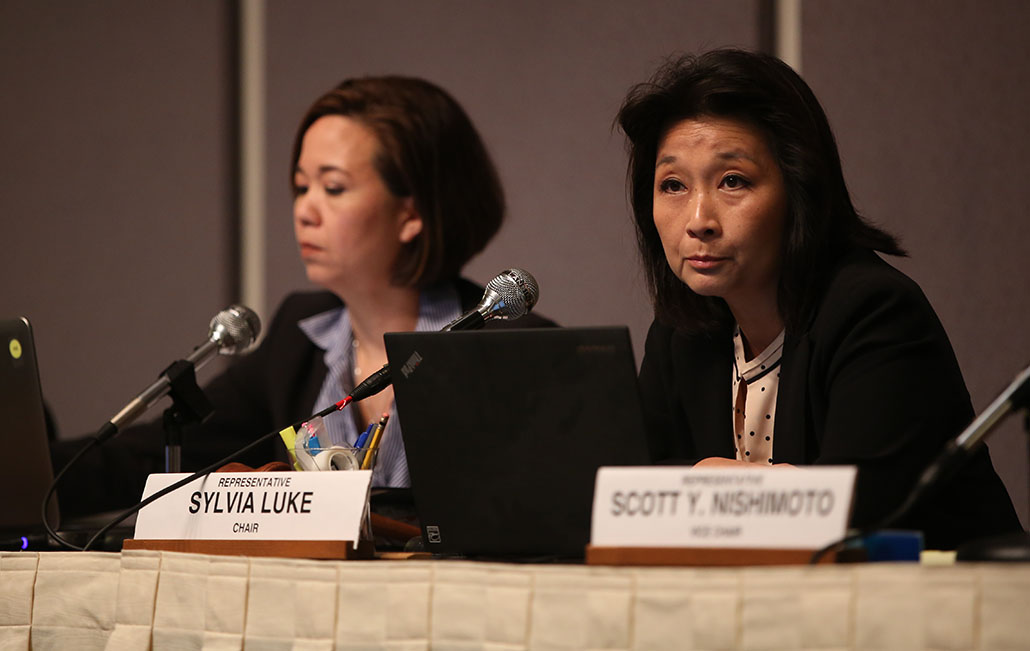Sen. Jill Tokuda, left, chair of the Senate Ways and Means Committee, and Rep. Sylvia Luke, chair of the House Finance Committee, listen to presentations by representatives of the Office of the Governor and the Department of Budget and Finance.