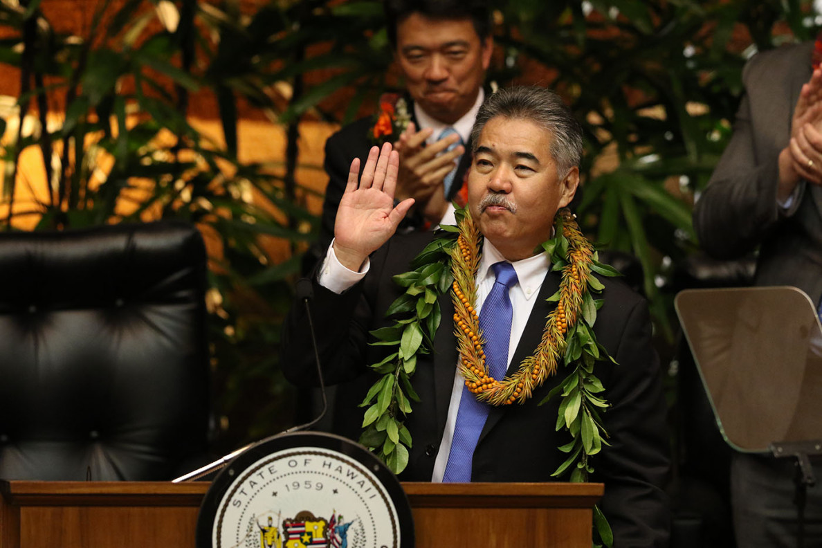 Gov. Ige waves to the audience before beginning his speech, which emphasized making Hawaii's government more efficient.