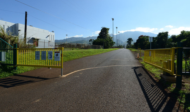 Gate adjacent to Waialua High School with road leading to Pioneer Hi-Bred International Inc. for Anita's story.  13 jan 2015. photograph Cory lum/Civil Beat