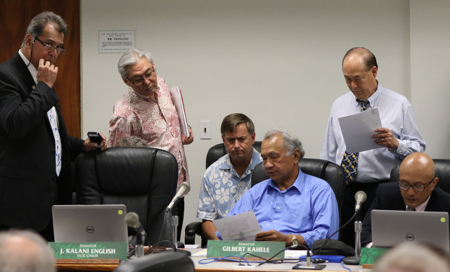 Center, Chair Gilbert Kahele looks on during a Senate Committee on Tourism and International affairs meeting. 18 feb 2015. photograph Cory Lum/Civil Beat