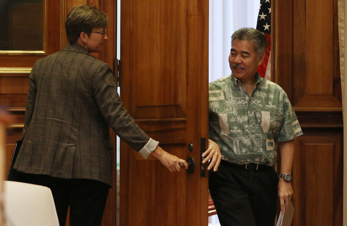 Gov. David Ige emerges from his office to talk with reporters as he holds his first general-topic press availability — something that as a candidate last year he said he'd do weekly.