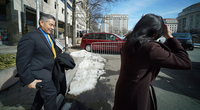 Special Advisor to the Governor Elizabeth Kim walks with Governor David Ige on their way to their next appointment. Washington DC.  23 feb 2015. photograph Cory Lum/Civil Beat