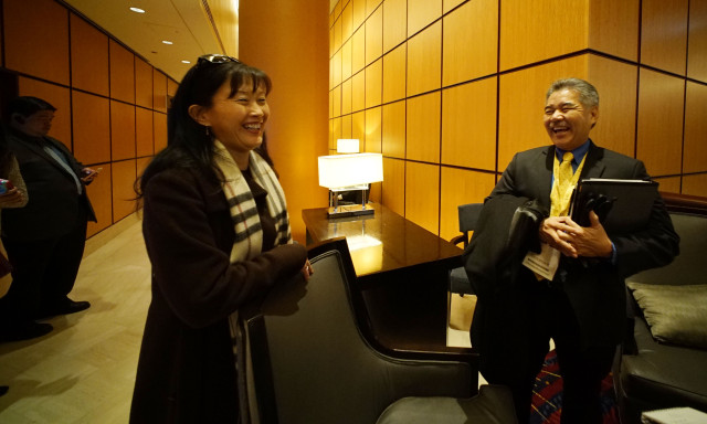 Special Advisor to the Governor Elizabeth Kim and Governor David Ige after interview inside the Marriot. Washington DC.  23 feb 2015. photograph Cory Lum/Civil Beat