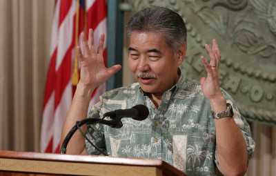 Governor David Ige gestures about the fact he recently found out the workers compensation process is not paperless during press conference.  12 feb 2015. photograph Cory Lum/Civil Beat
