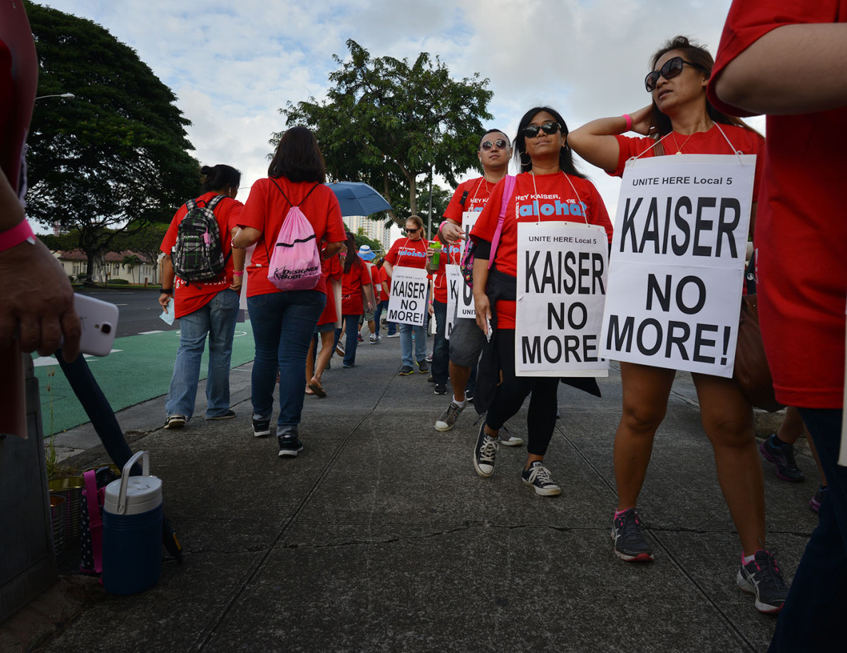 Members of the Local 5 union begin a six-day strike Monday outside Kaiser Permanente's Honolulu Office on King Street.