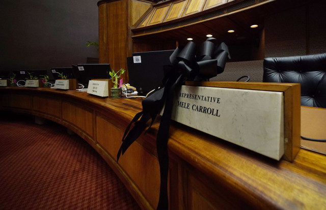 Black ribbon rests on the desk of the late Representative Mele Carroll who passed away early this morning.  18 feb 2015. photograph Cory Lum/Civil Beat