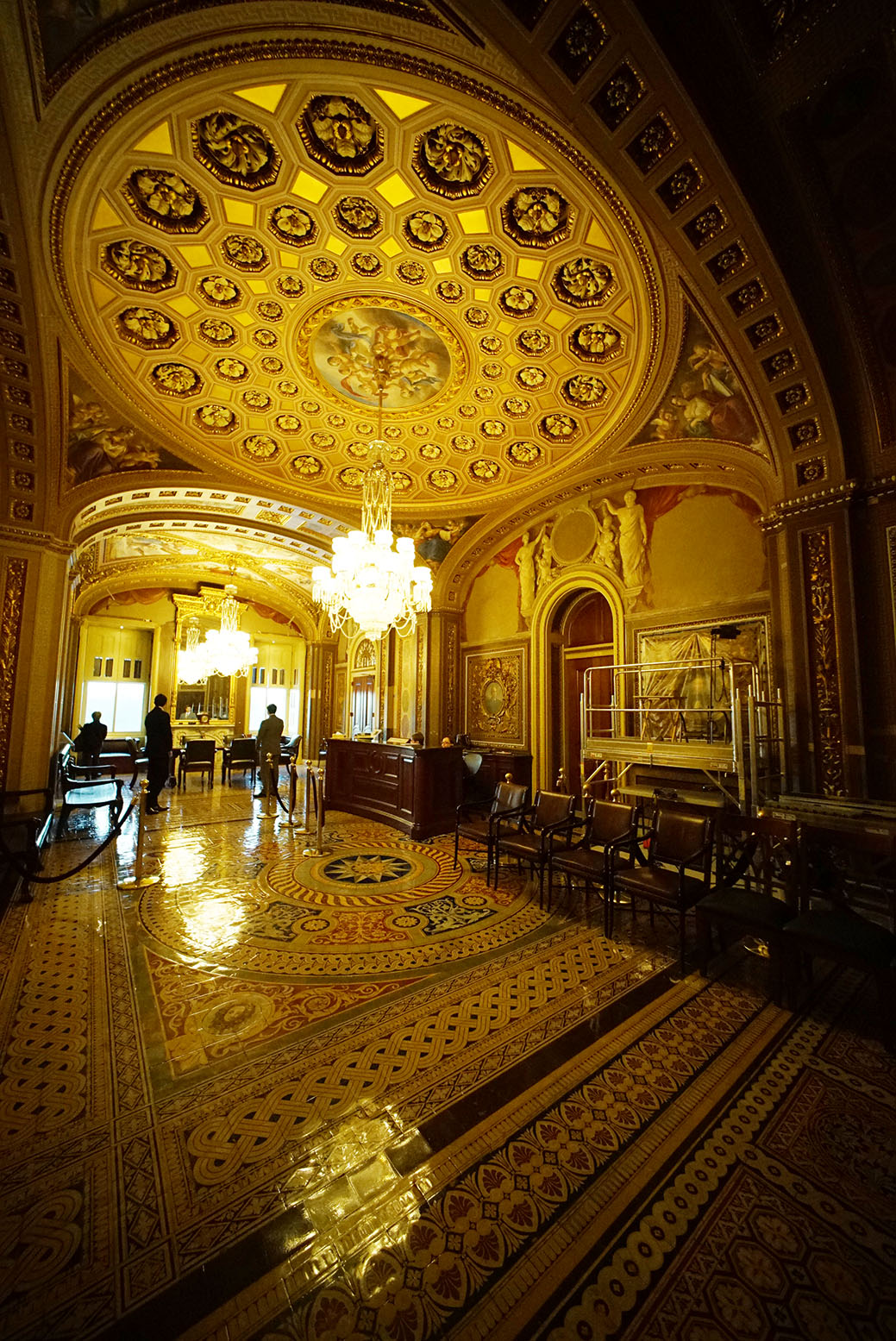 In a much warmer scene inside the Capitol, chandeliers are reflected in the Senate Reception Room.