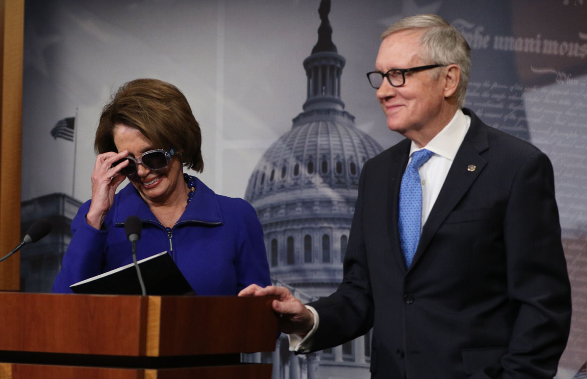 House Minority Leader Nancy Pelosi dons sunglasses in solidarity with Senate Minority Leader Harry Reid, who has an injured eye, before a press conference Wednesday to discuss the Department of Homeland Security funding showdown.