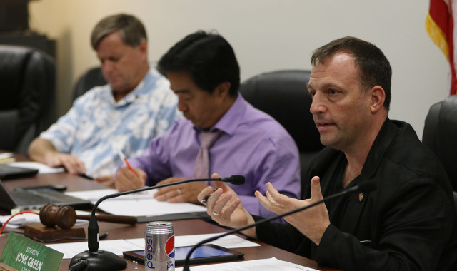 Then Senate Health Committee Chair Josh Green, right, speaks at a hearing on a bill that would establish medical marijuana production centers and dispensaries in Hawaii, February 2015.
