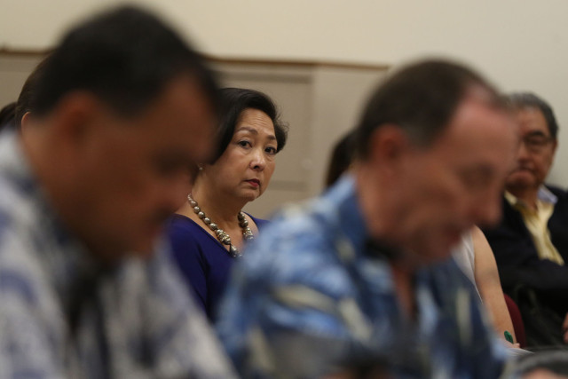 State Auditor Jan Yamane looks on as Jeff Kissell, Executive Director of the Hawaii Health Connector speaks to lawmakers after the auditor presented her report. 9 feb 2015. photograph Cory Lum/Civil beat