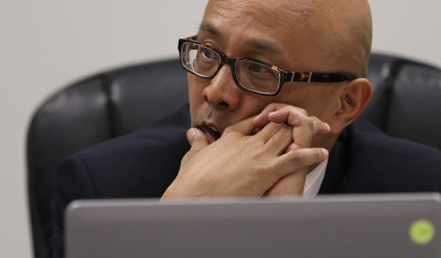 Senator Will Espero looks on during a Senate Committee on Tourism and International affairs meeting. 18 feb 2015. photograph Cory Lum/Civil Beat
