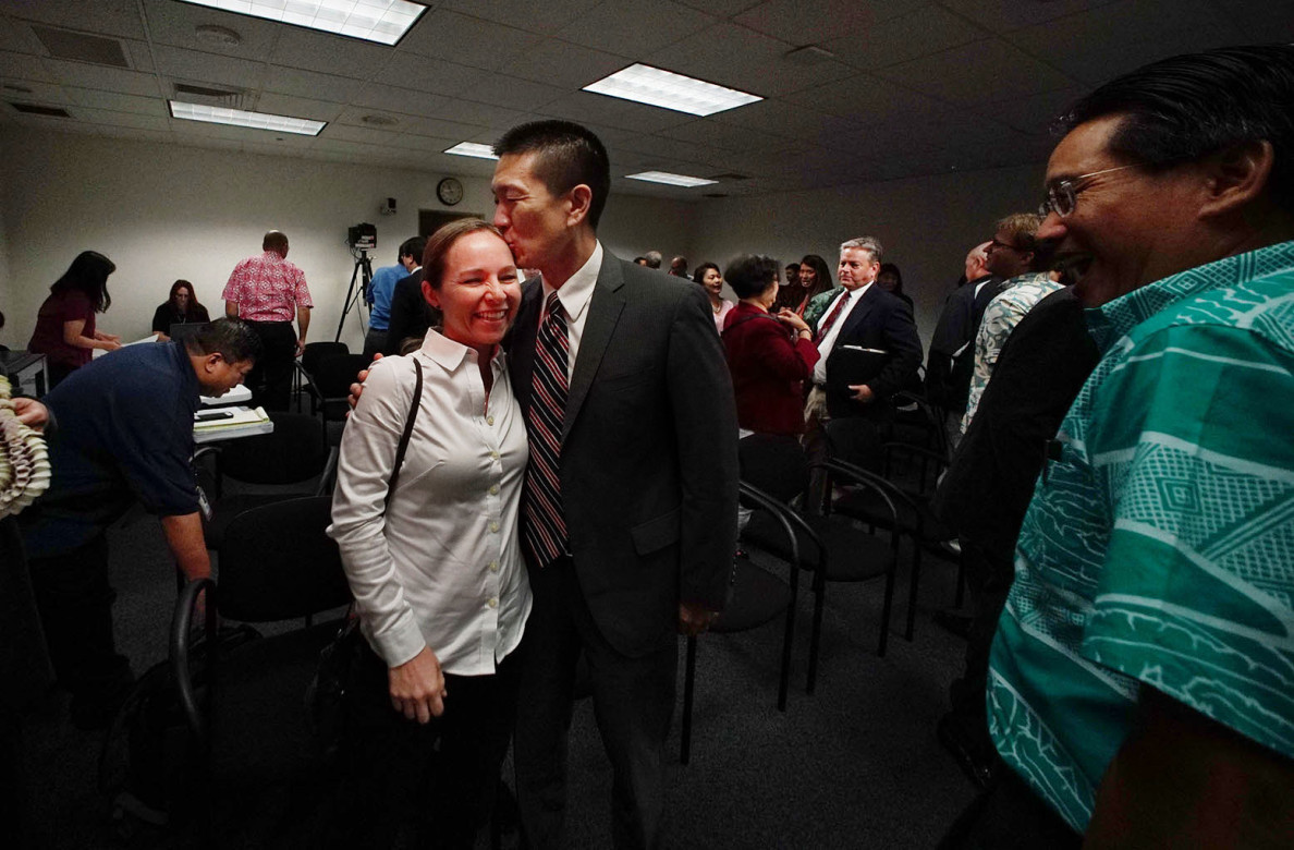 Doug Chin celebrates with his wife after his nomination to be state attorney general sailed through the Senate Judiciary Committee on Feb. 13.