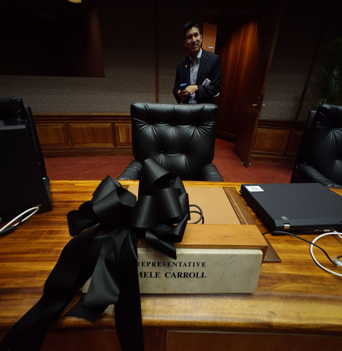 A black ribbon was placed at the desk of former Rep. Mele Carroll after news of her death on Maui reached the Capitol on Wednesday.